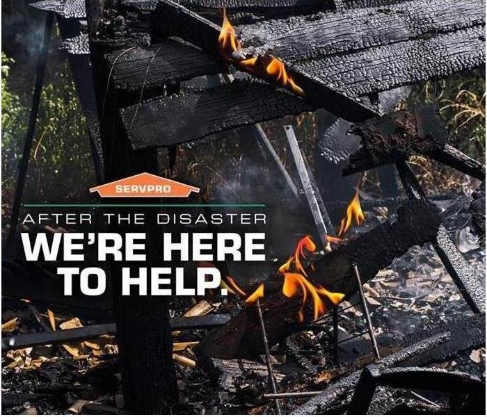 A structure is burned with flames in the background and captioned is SERVPRO we